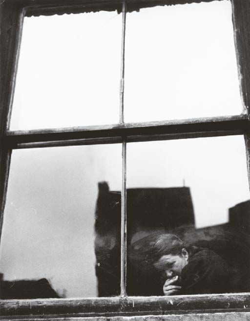 Leon Levinstein, Untitled (figure at a window),1950's